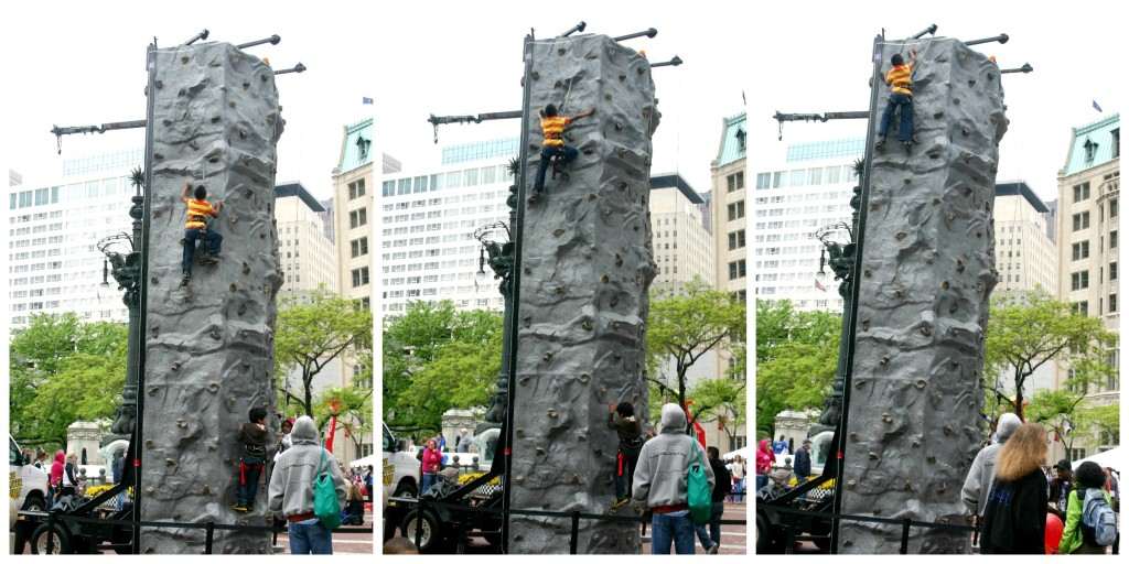 Boy climbing rock wall at the Chase 500 Festival Kids' Day