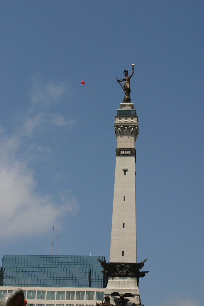 Monument with red balloon floating by at Chase 500 Festival Kids' Day