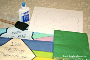 Materials needed for tissue covered shamrock craft.
